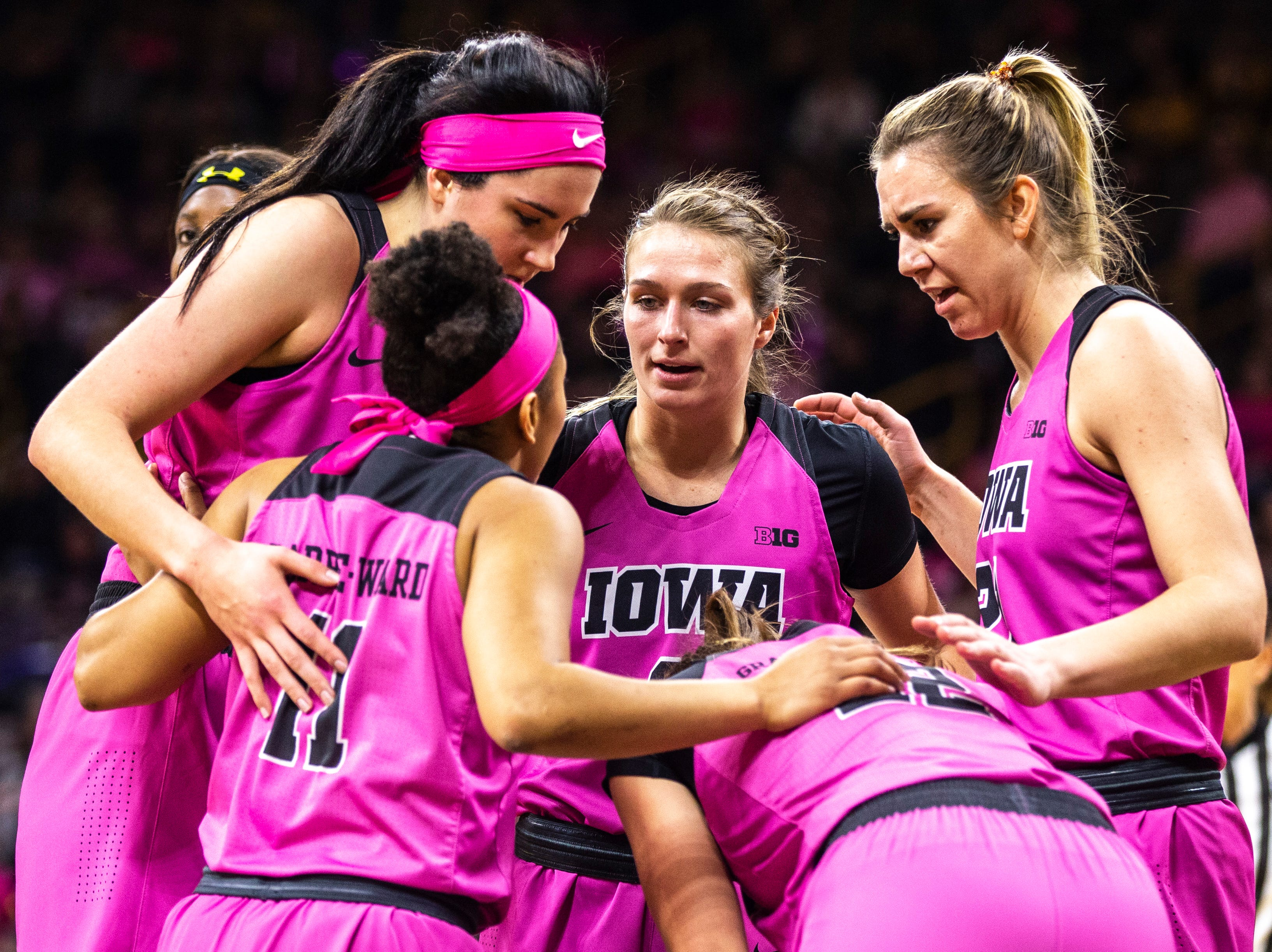 Iowa Hawkeyes Megan Gustafson (clockwise from top left) Makenzie Meyer, Hannah Stewart, Kathleen Doyle and  Tania Davis huddle during a NCAA Big Ten Conference women's basketball game on Sunday, Feb. 17, 2019 at Carver-Hawkeye Arena in Iowa City, Iowa.