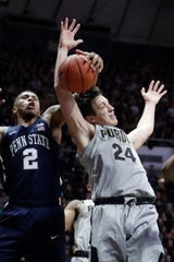 Penn State guard Myles Dread (2) and Purdue forward Grady Eifert (24) become entangled as they go up for a rebound on Saturday.