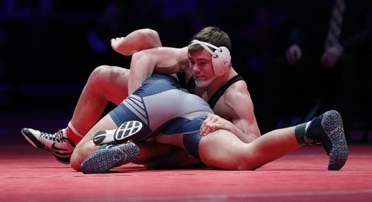 Greenwood's Nick Willham wrestles Shenandoah's Silas Allred in the 195 lbs. IHSAA State Wrestling Championship match at Bankers Life Fieldhouse on Saturday, Feb 16., 2018.