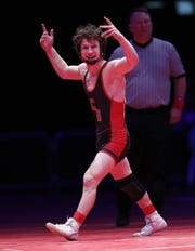 Center Grove's Brayden Littell celebrates his win over Evansville Mater Dei's Blake Boarman in the 120 lbs. IHSAA State Wrestling Championship match at Bankers Life Fieldhouse on Saturday, Feb 16., 2018.