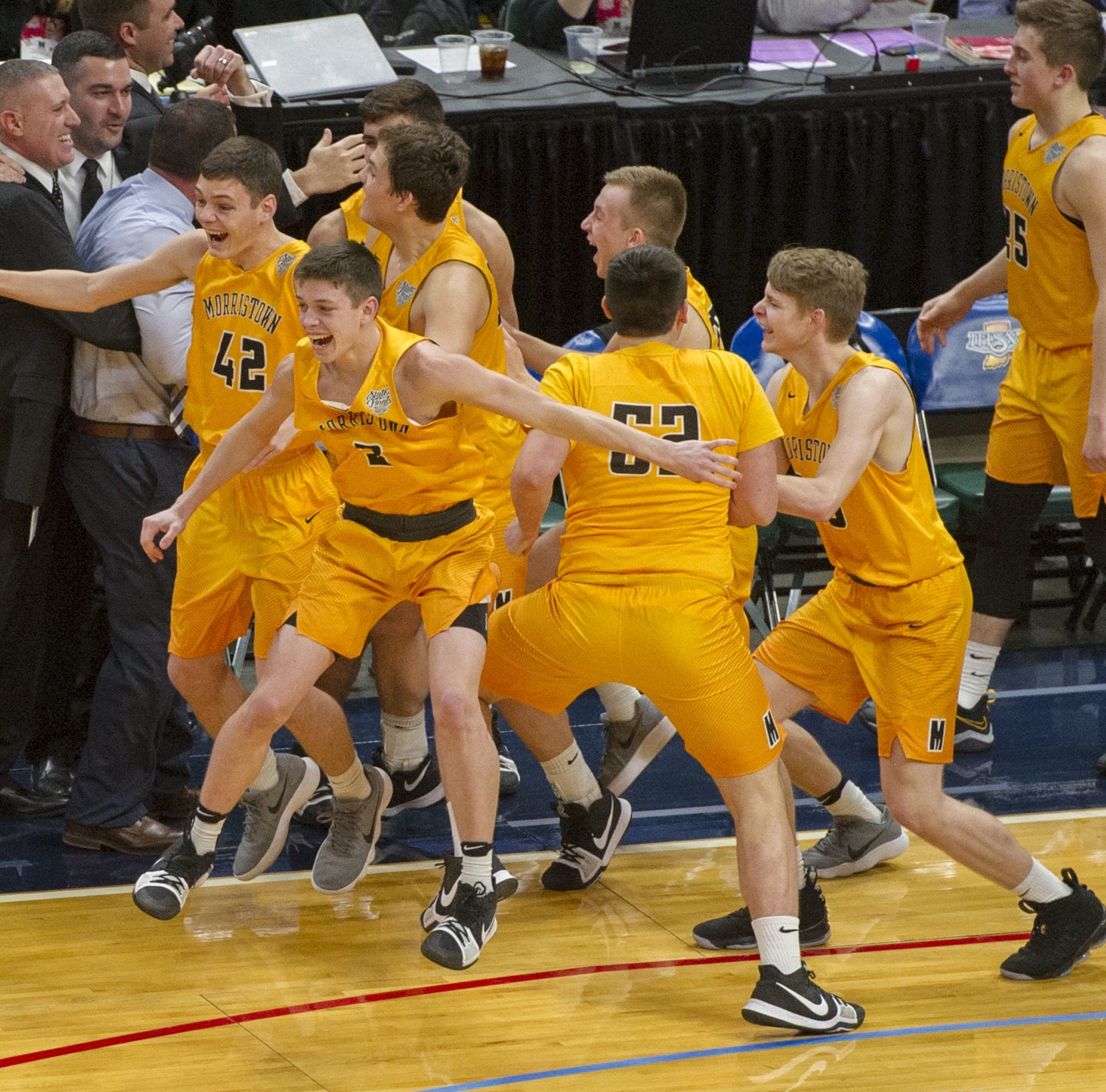 The Morristown bench erupts after winning the 2018 IHSAA Class A state final at Bankers Life Fieldhouse.