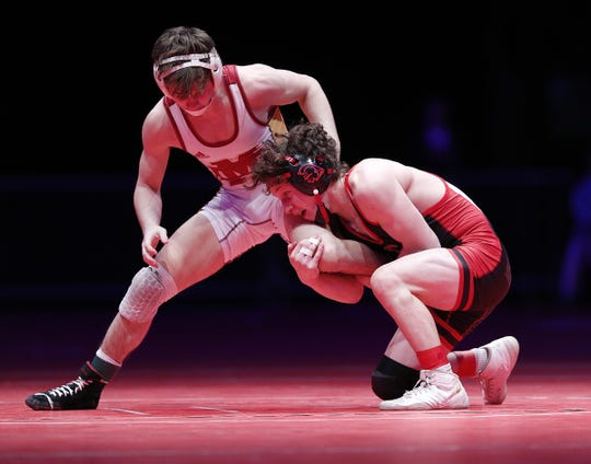 Center Grove's Brayden Littell wrestles Evansville Mater Dei's Blake Boarman in the 120 lbs. IHSAA State Wrestling Championship match at Bankers Life Fieldhouse on Saturday, Feb 16., 2018.