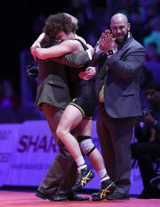 Avon's Asa Garcia hugs his coach after pinning Roncalli's Alec Viduya in the 132 lbs. IHSAA State Wrestling Championship match at Bankers Life Fieldhouse on Saturday, Feb 16., 2018.