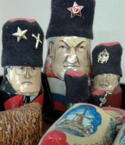 Stacking dolls of famous Russian political figures are some of the many international gifts and artifacts displayed in the home office occupied by WorldLink in Kalona.