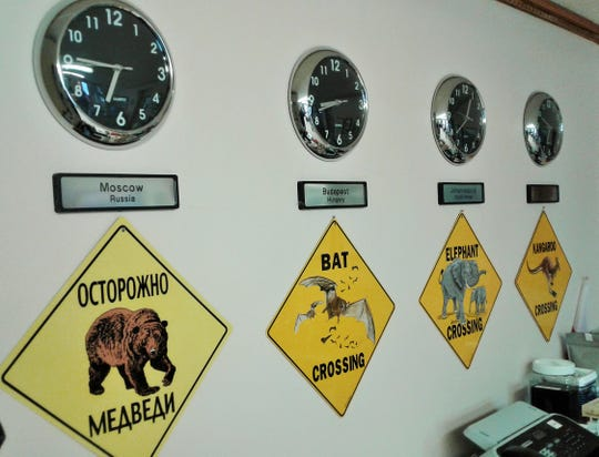Operating WorldLink often involves connecting with people in international cities in other time zones, as signified by these clocks in the non-profit's Kalona headquarters.
