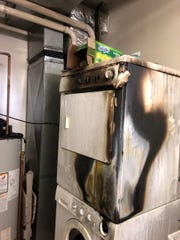 A burnt washing machine and dryer after a fire at  204 Summerhill Drive in the Town of Ithaca.
