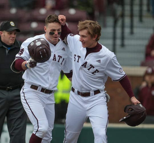 Mississippi State's Tanner Allen (5) is congratulated by a teammate after hitting a home run. Mississippi State played Youngstown State on Saturday, February 16, 2019. Photo by Keith Warren
