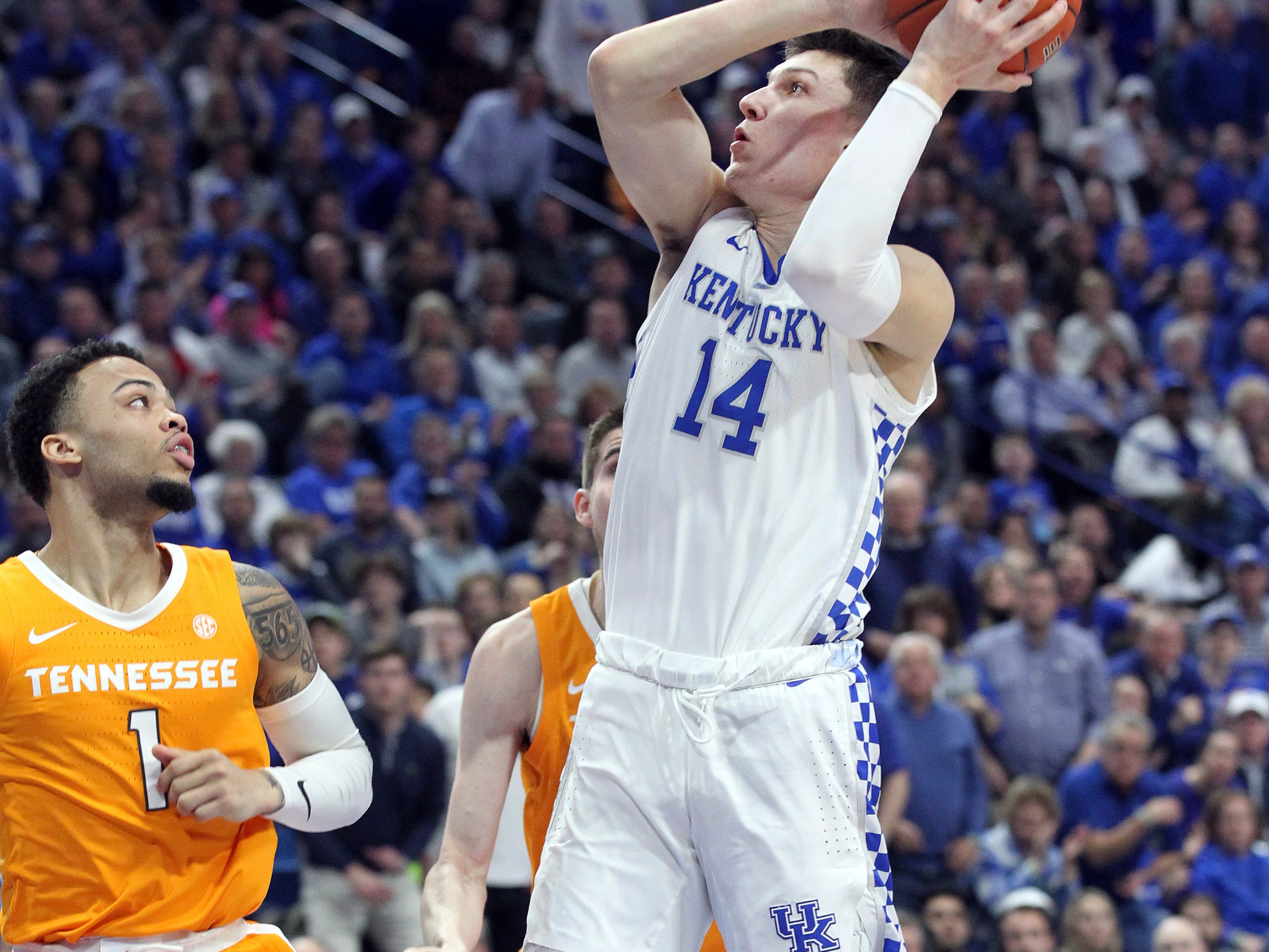 Kentucky's Tyler Herro (14) shoots near Tennessee's Lamonte Turner (1) during the first half of an NCAA college basketball game in Lexington, Ky., Saturday, Feb. 16, 2019. (AP Photo/James Crisp)