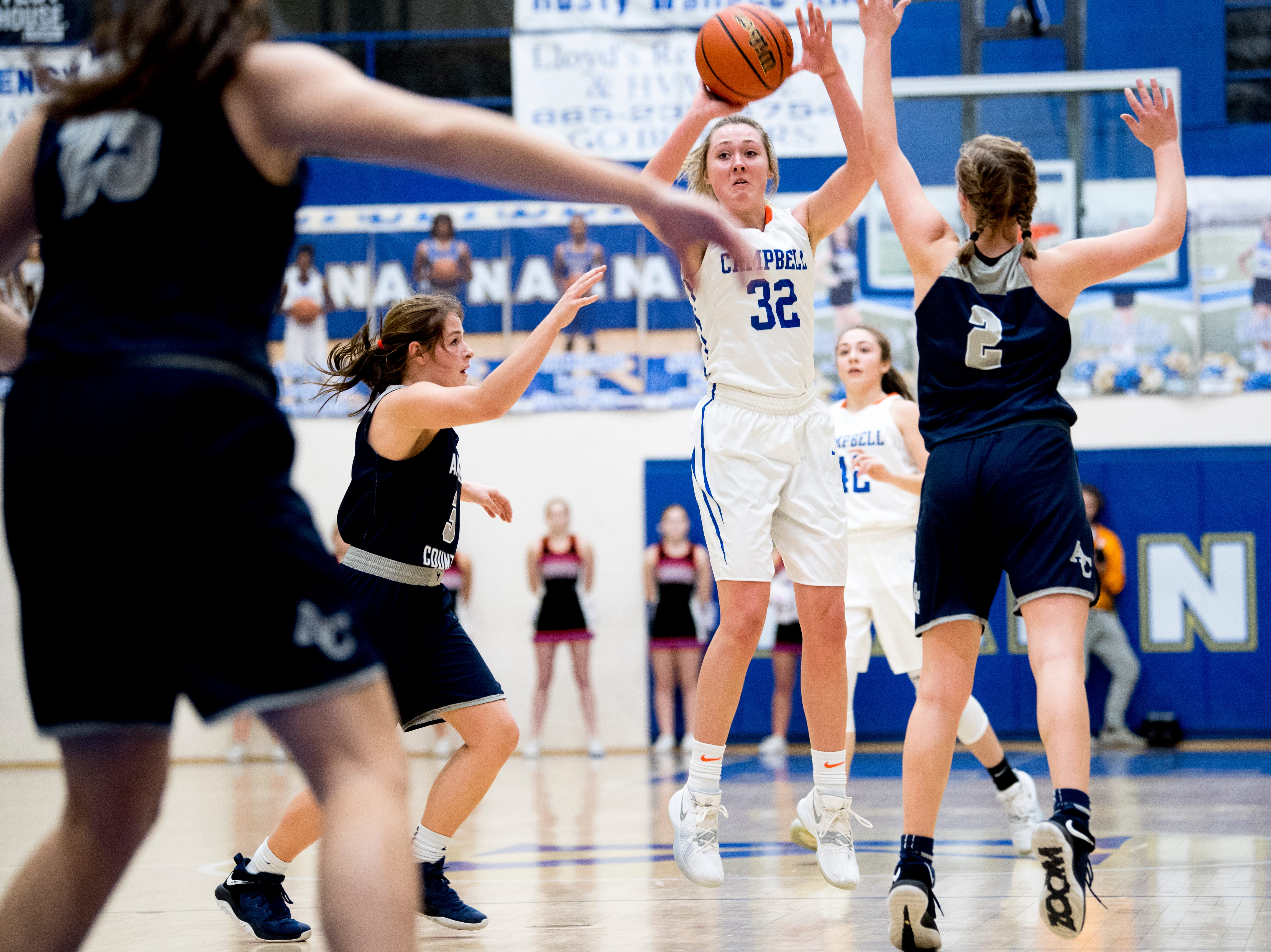 Campbell County's Skylar Boshears (32) shoots the ball as Anderson County's Shae Berry (2) defends during a game between semifinal game between Anderson County and Campbell County at Karns High School in Knoxville, Tennessee on Saturday, February 16, 2019.