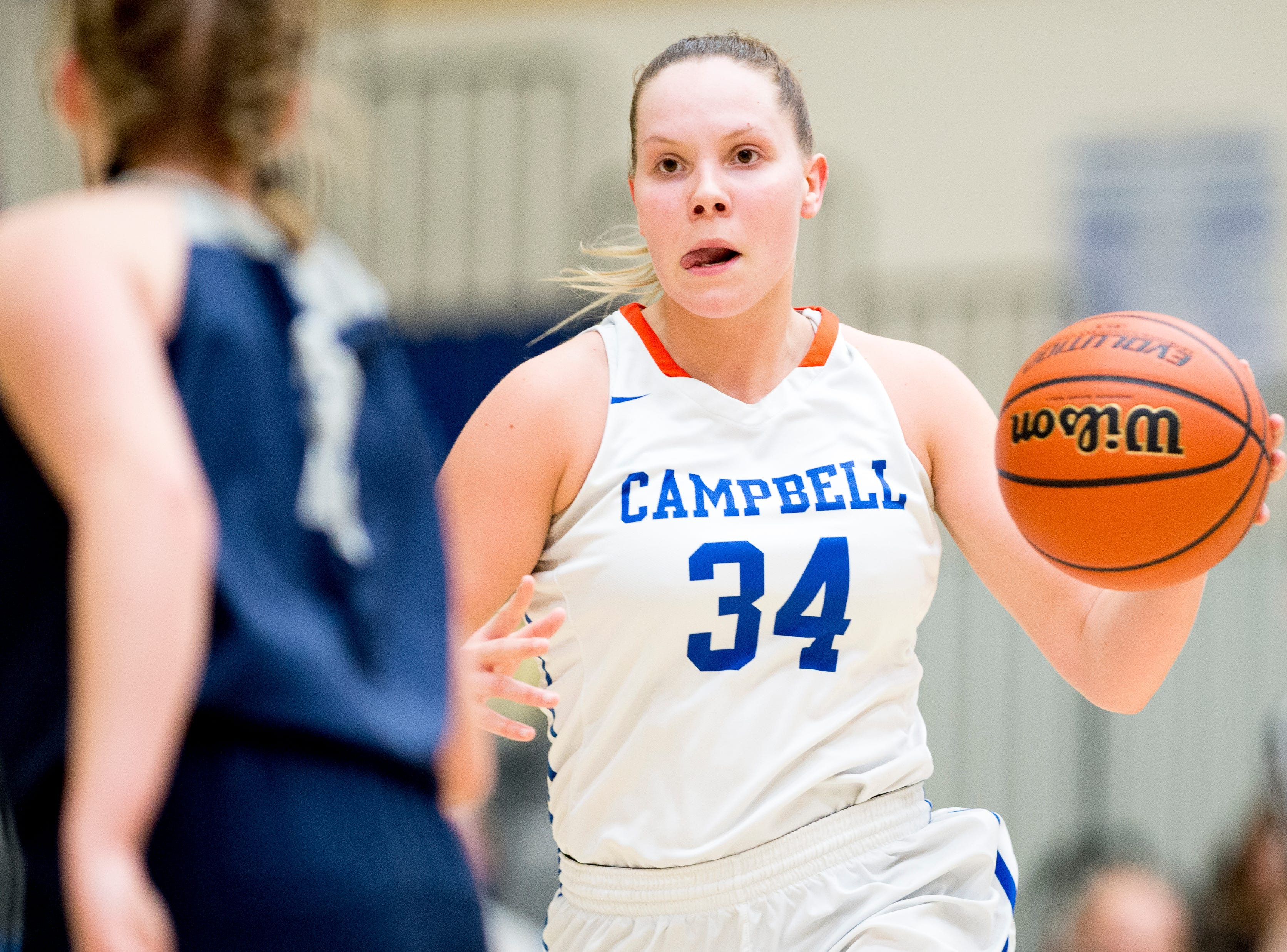 Campbell County's Haley Comer (34) dribbles down the court during a game between semifinal game between Anderson County and Campbell County at Karns High School in Knoxville, Tennessee on Saturday, February 16, 2019.