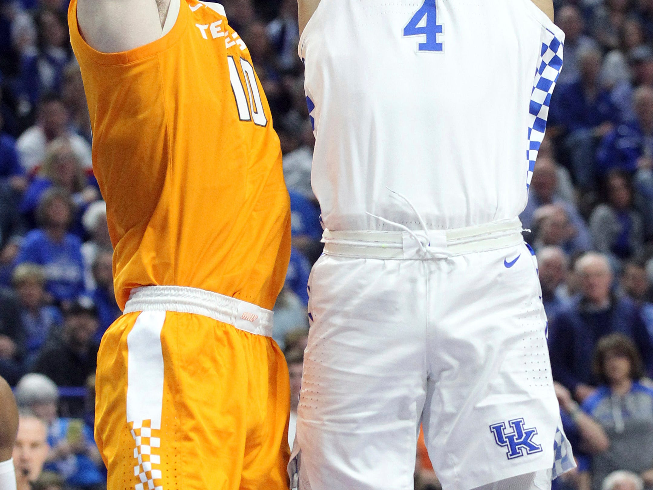 Kentucky's Nick Richards (4) shoots while defended by Tennessee's John Fulkerson (10) during the first half of an NCAA college basketball game in Lexington, Ky., Saturday, Feb. 16, 2019. (AP Photo/James Crisp)