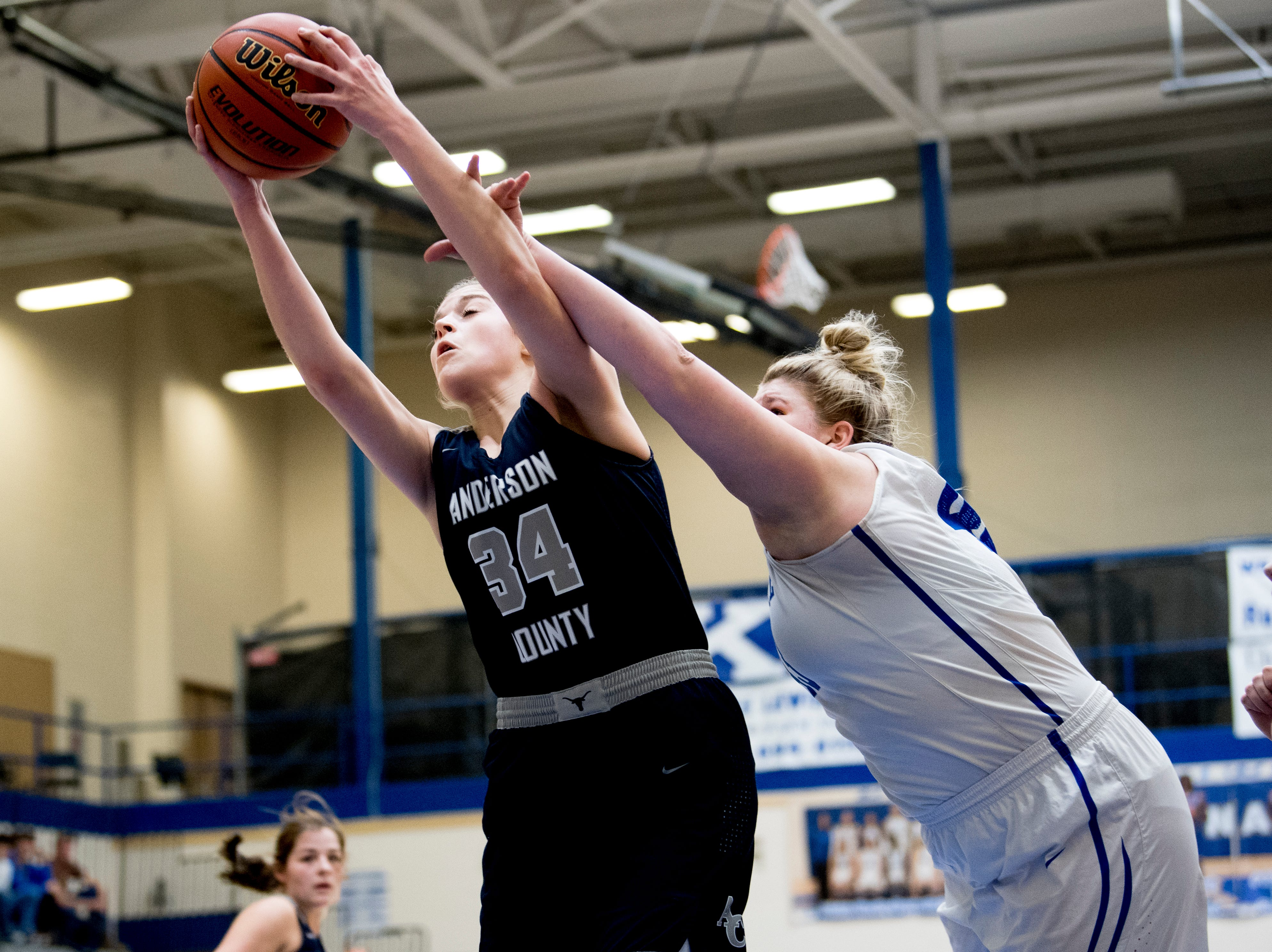 Anderson County's Brooklyn McCoy (34) grabs the rebound past Campbell County's Madison Brady (43) during a game between semifinal game between Anderson County and Campbell County at Karns High School in Knoxville, Tennessee on Saturday, February 16, 2019.