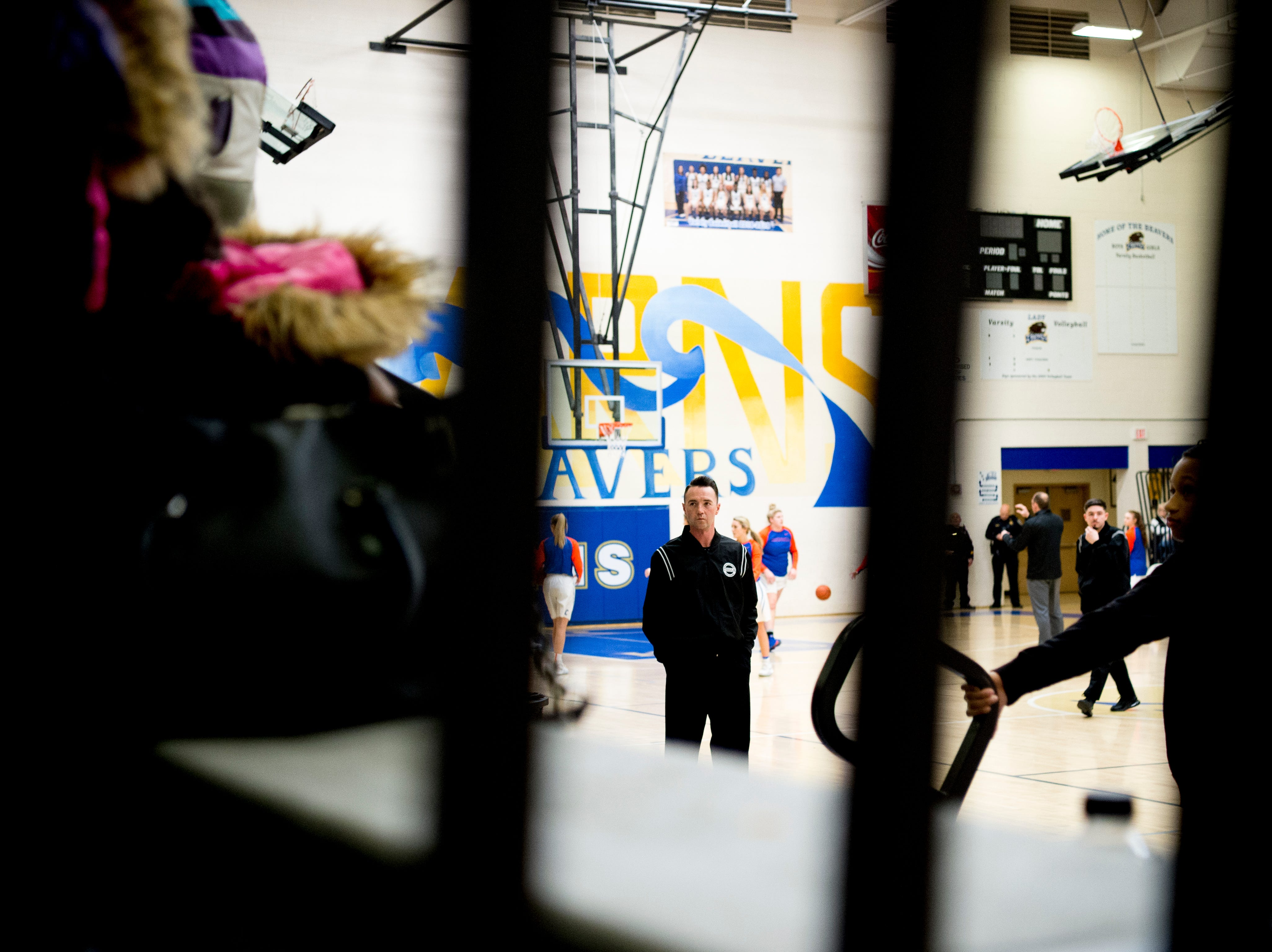 A referee waits for the start of the game during a semifinal game at Karns High School in Knoxville, Tennessee on Saturday, February 16, 2019.