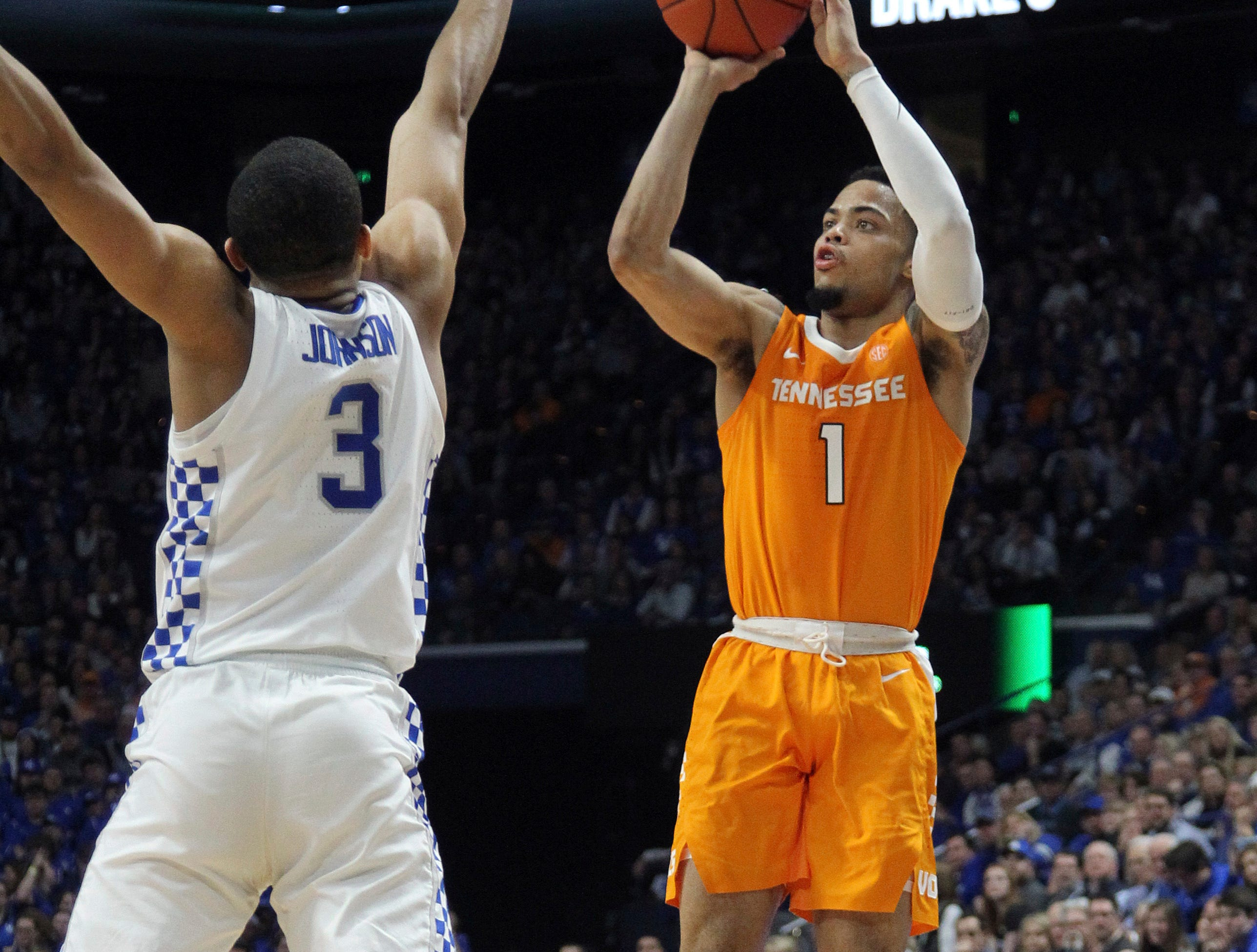 Tennessee's Lamonte Turner (1) shoots while defended by Kentucky's Keldon Johnson (3) during the second half of an NCAA college basketball game in Lexington, Ky., Saturday, Feb. 16, 2019. Kentucky won 86-69. (AP Photo/James Crisp)