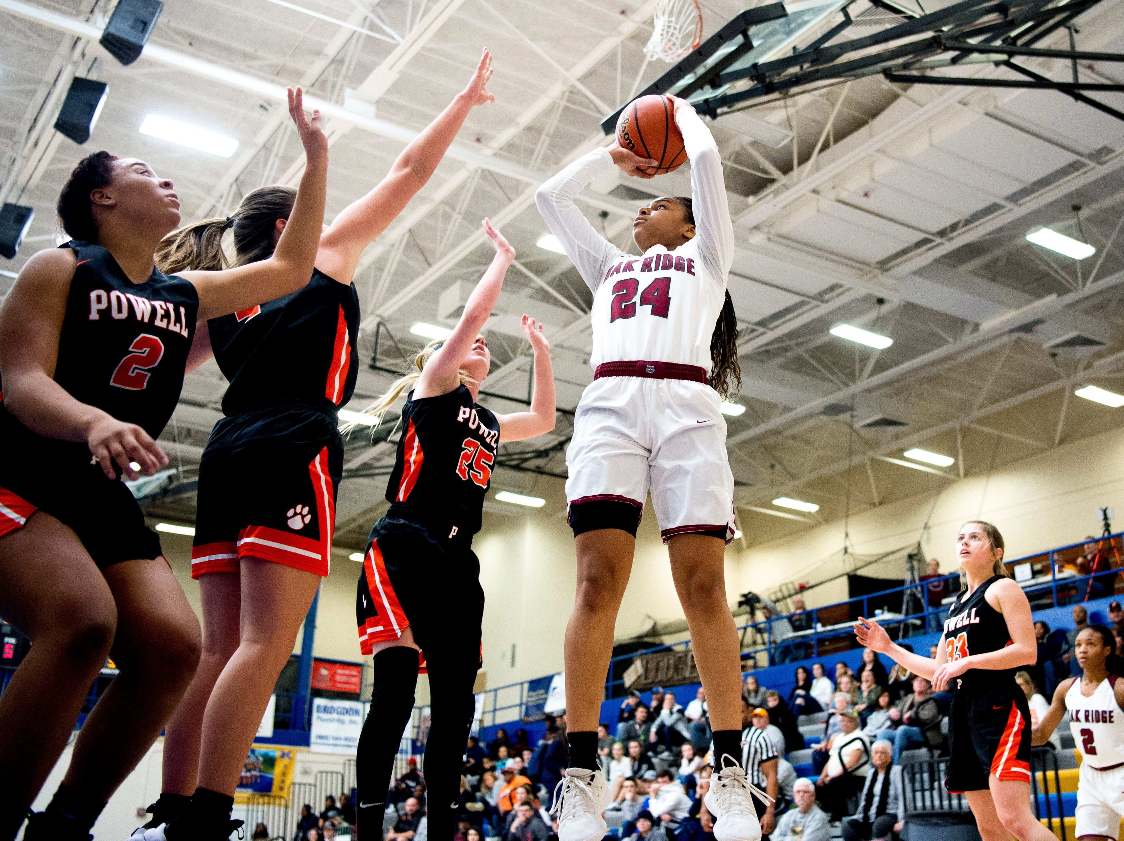 Oak Ridge's Jada Guinn (24) shoots the ball as Powell defends during a game between semifinal game between Oak Ridge and Powell at Karns High School in Knoxville, Tennessee on Saturday, February 16, 2019.