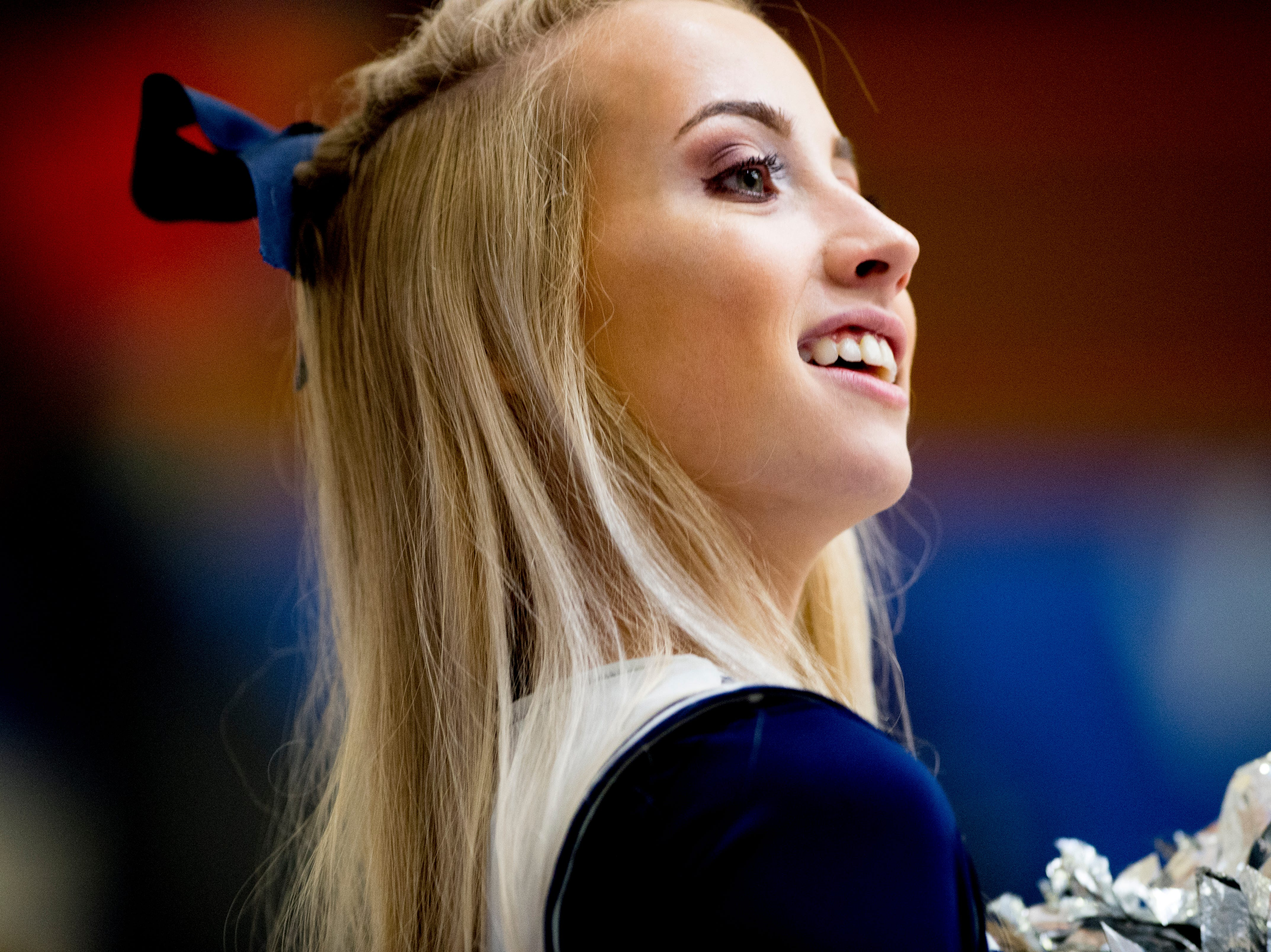 An Anderson County cheerleader cheers during a semifinal game at Karns High School in Knoxville, Tennessee on Saturday, February 16, 2019.