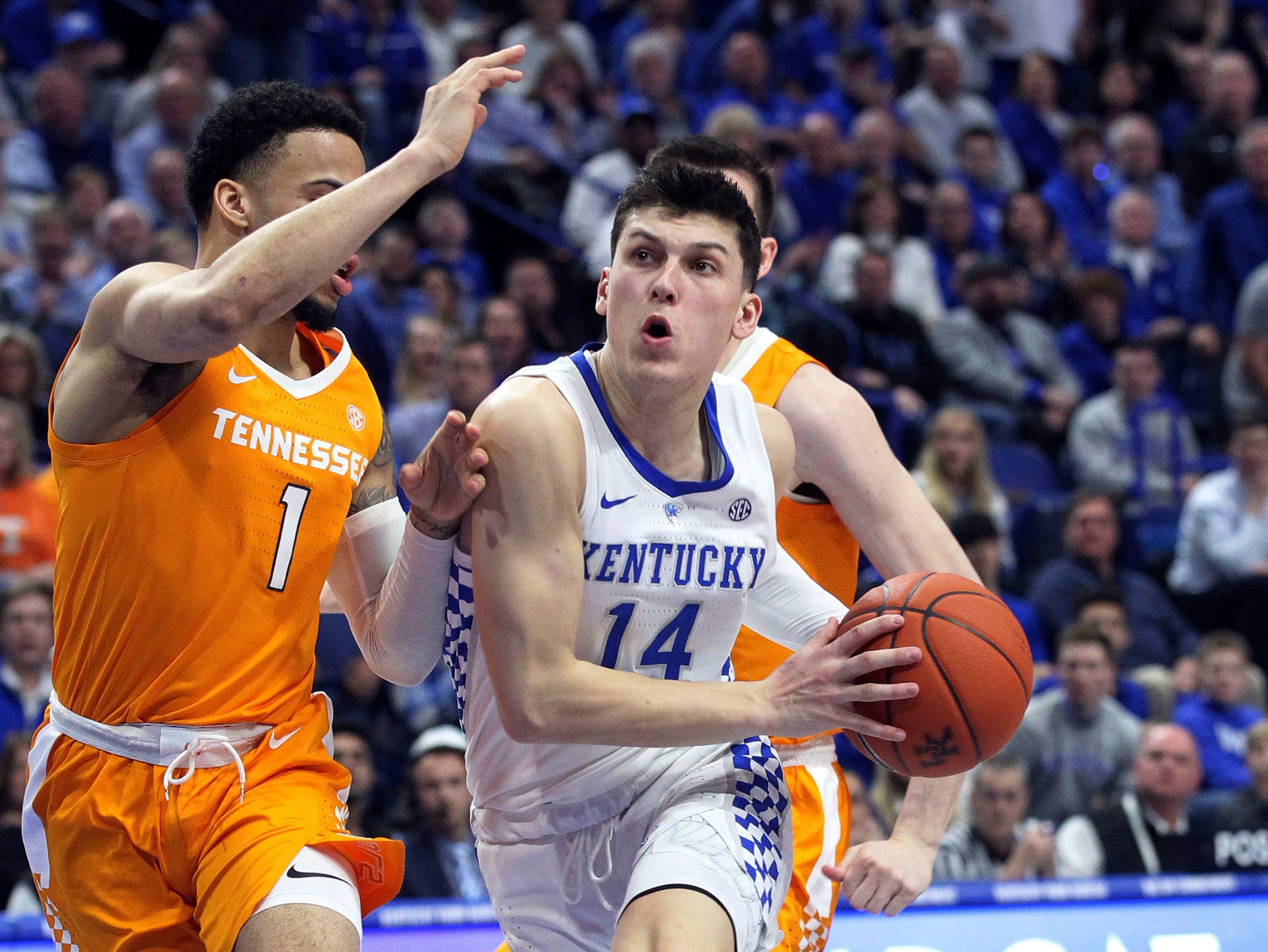 Kentucky's Tyler Herro (14) drives on Tennessee's Lamonte Turner (1) during the first half of an NCAA college basketball game in Lexington, Ky., Saturday, Feb. 16, 2019. (AP Photo/James Crisp)