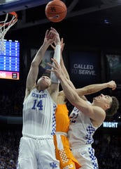 Tennessee's Lamonte Turner, middle tries for a rebound between Kentucky's Tyler Herro (14) and Reid Travis during the second half of an NCAA college basketball game in Lexington, Ky., Saturday, Feb. 16, 2019. Kentucky won 86-69. (AP Photo/James Crisp)
