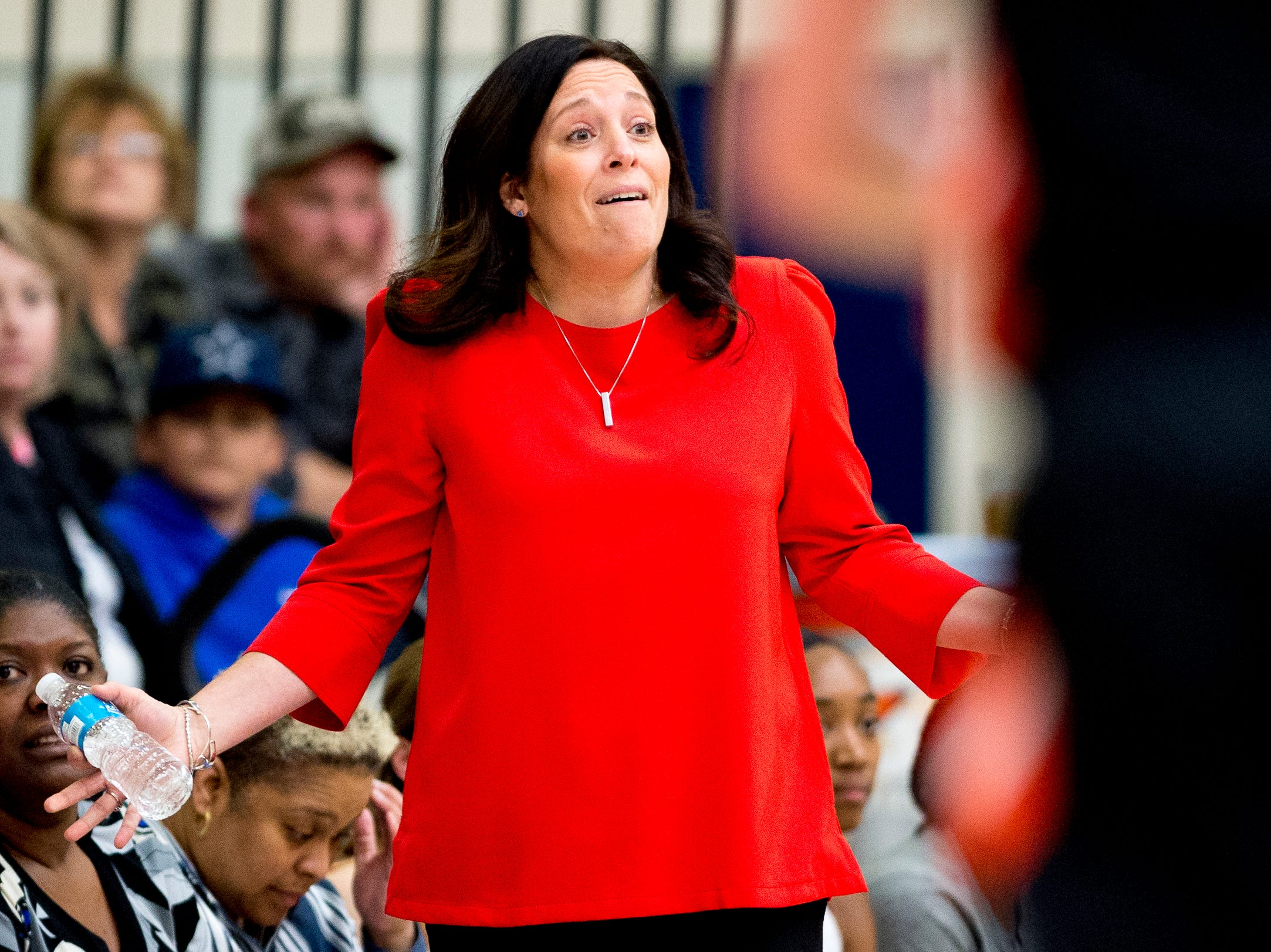 Oak Ridge Girls Head Coach Paige Redman reacts to the game during a game between semifinal game between Oak Ridge and Powell at Karns High School in Knoxville, Tennessee on Saturday, February 16, 2019.
