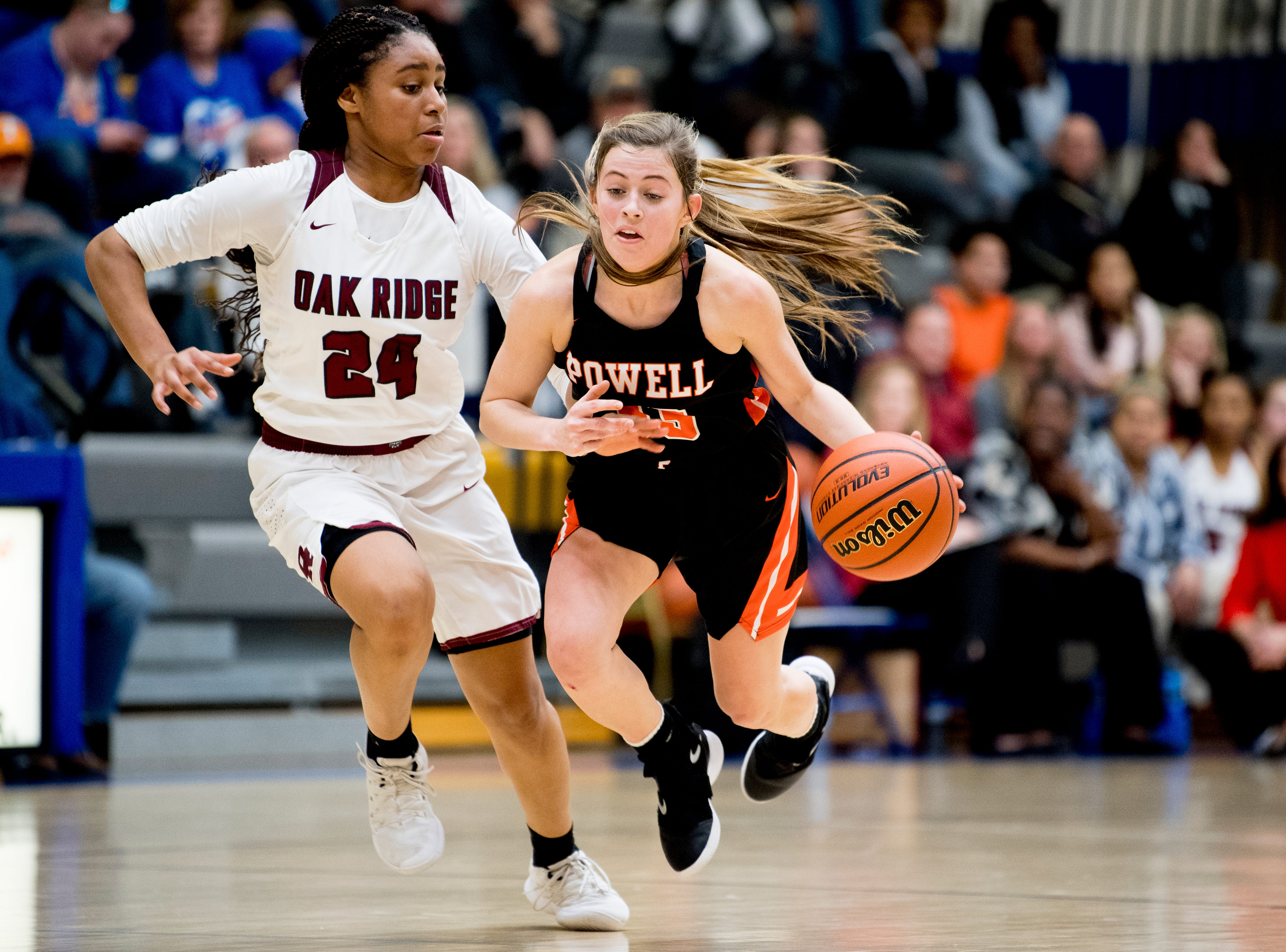 Oak Ridge's Jada Guinn (24) bumps into Powell's Savanna Parker (33), knocking her over, during a game between semifinal game between Oak Ridge and Powell at Karns High School in Knoxville, Tennessee on Saturday, February 16, 2019.