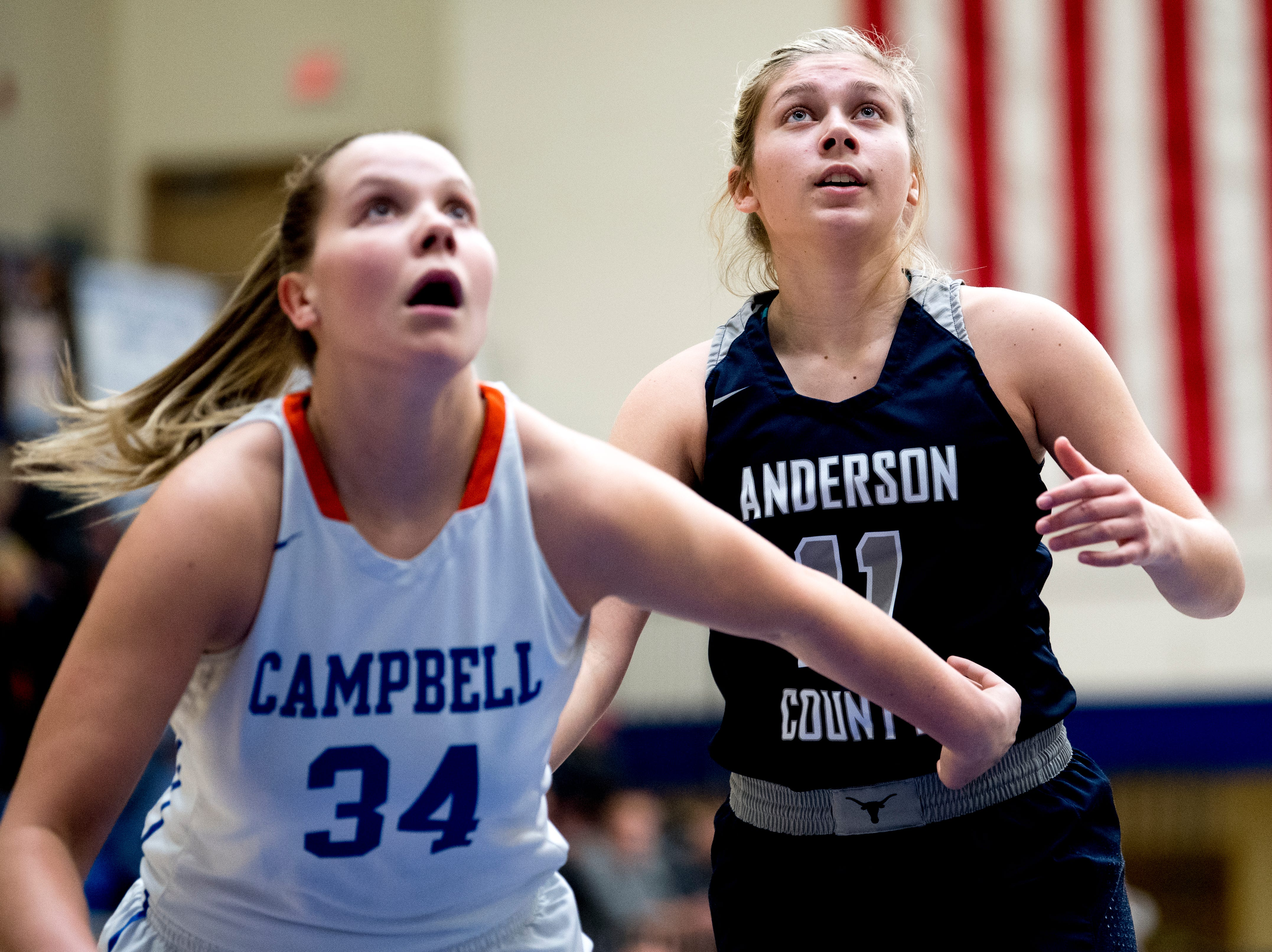 Campbell County's Haley Comer (34) and Anderson County's Juliann Smith (11) eye the rebound during a game between semifinal game between Anderson County and Campbell County at Karns High School in Knoxville, Tennessee on Saturday, February 16, 2019.