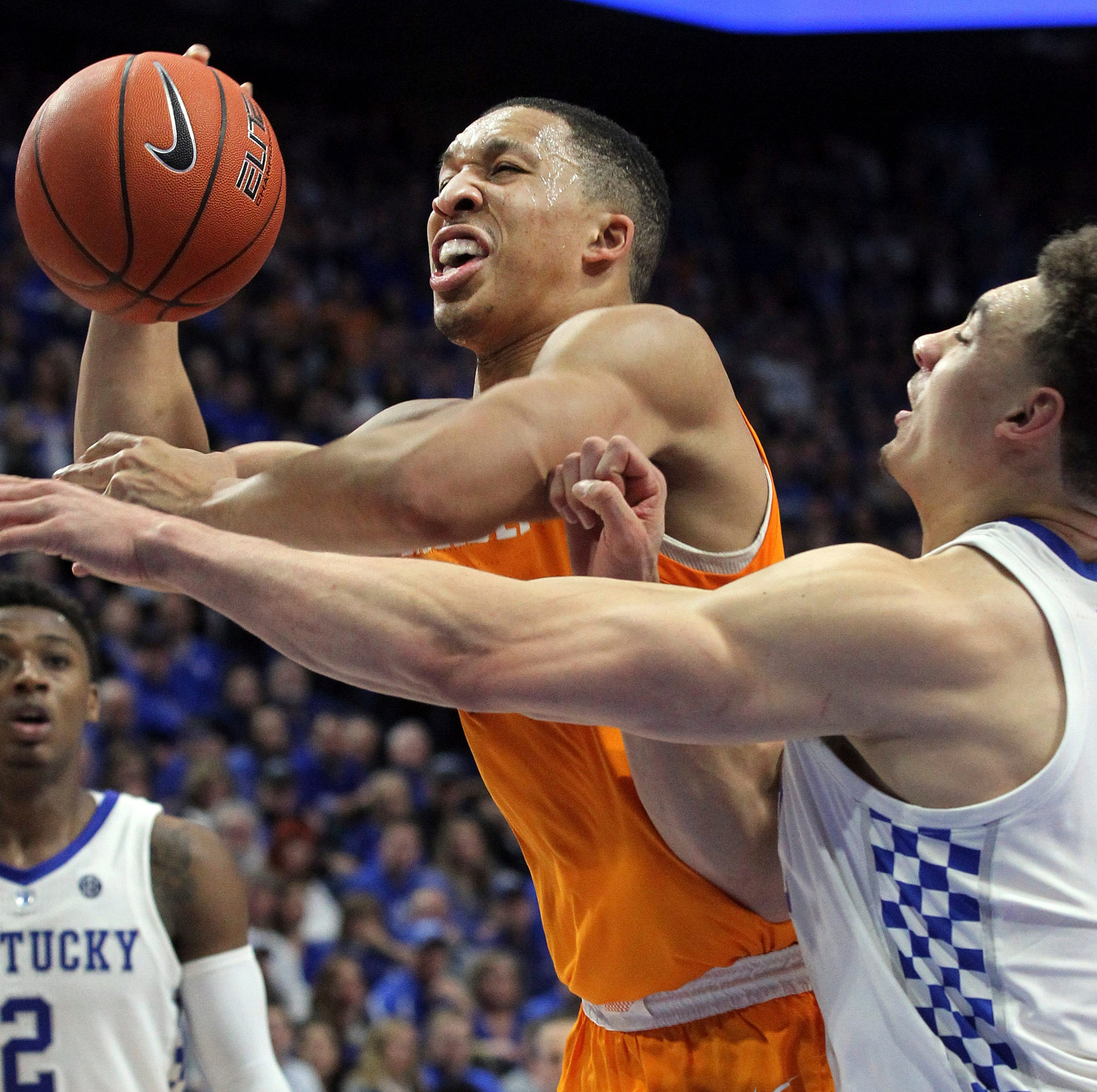 Tennessee's Grant Williams, left, shoots while...