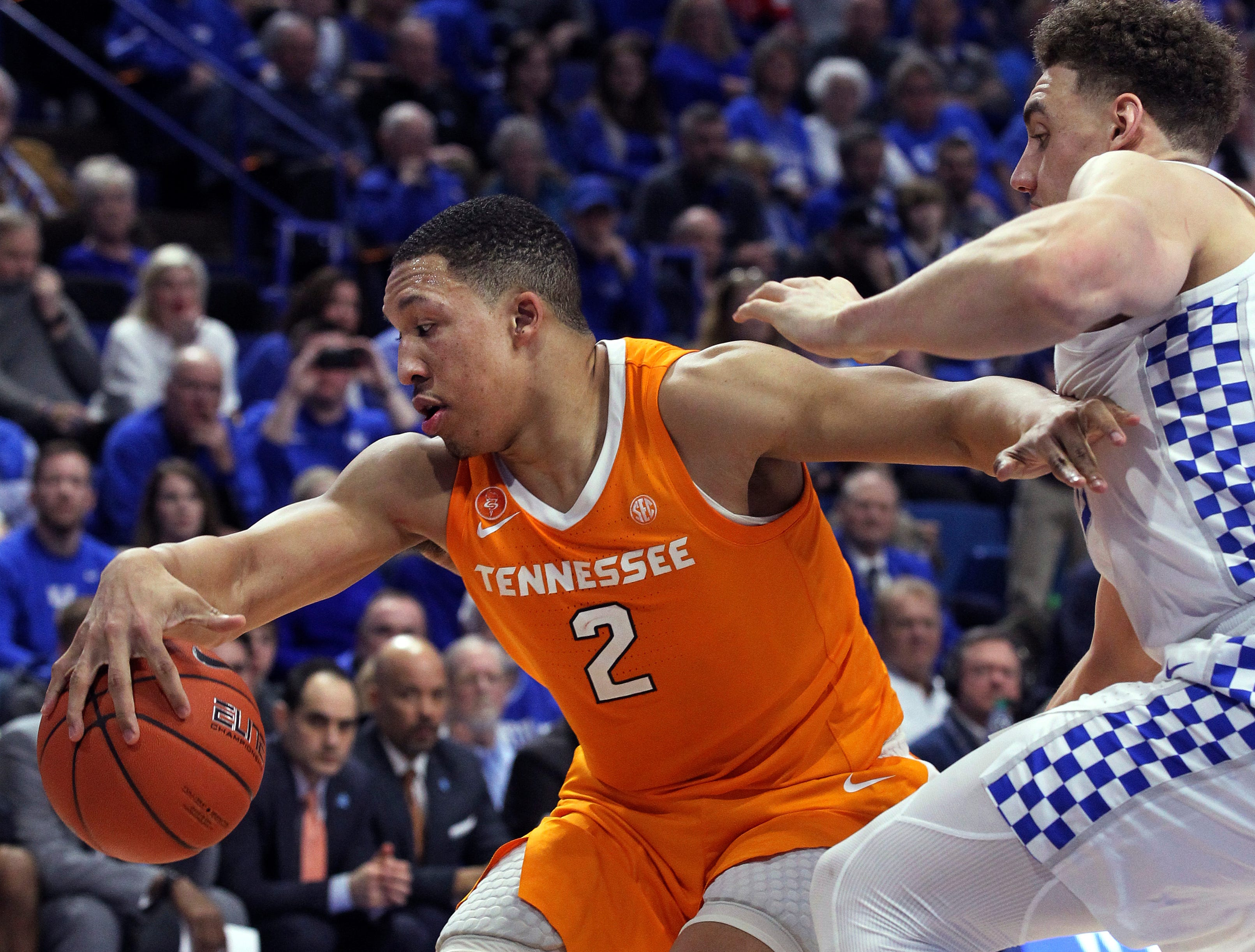 Tennessee's Grant Williams (2) looks for an opening on Kentucky's Reid Travis during the second half of an NCAA college basketball game in Lexington, Ky., Saturday, Feb. 16, 2019. Kentucky won 86-69.(AP Photo/James Crisp)