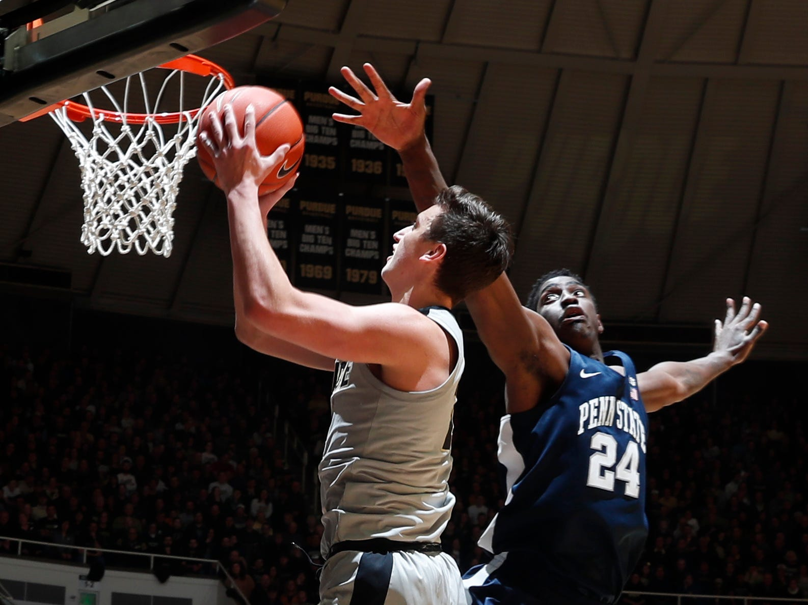 Feb 16, 2019; West Lafayette, IN, USA; Purdue Boilermakers forward Grady Eiftert (24) takes a shot against Penn State Nittany Lions forward Mike Watkins (24) during the second half at Mackey Arena. Mandatory Credit: Brian Spurlock-USA TODAY Sports