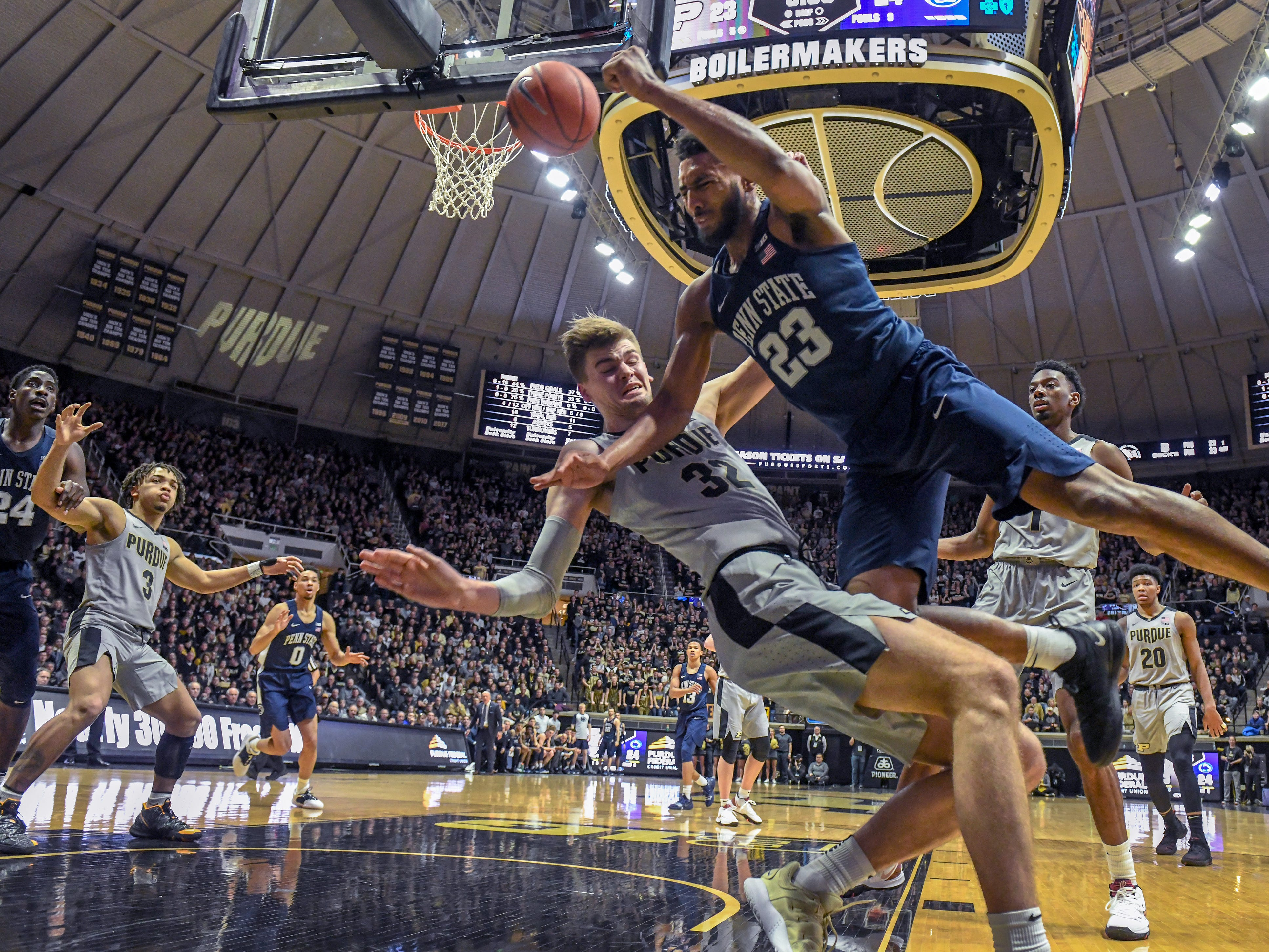By Frank Oliver for the Journal and Courier -- Purdue's Matt Haarms takes a charge as Penn State's Josh Reaves drives the baseline in the first half at Purdue on Saturday February 16, 2019.