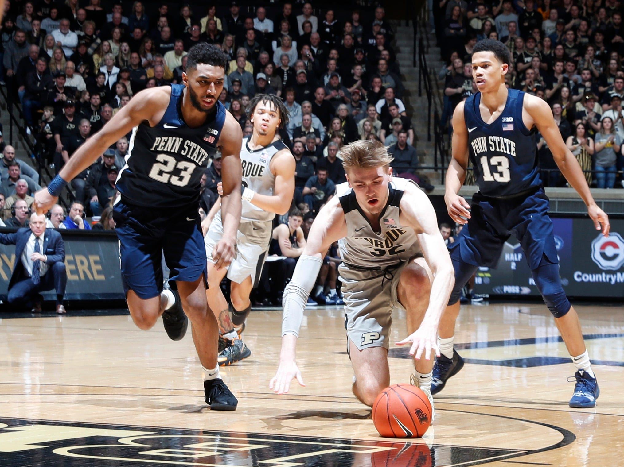 Feb 16, 2019; West Lafayette, IN, USA; Purdue Boilermakers center Matt Haarms (32) is fouled as he drives to the basket against Penn State Nittany Lions guard Josh Reaves (23) during the second half at Mackey Arena. Mandatory Credit: Brian Spurlock-USA TODAY Sports