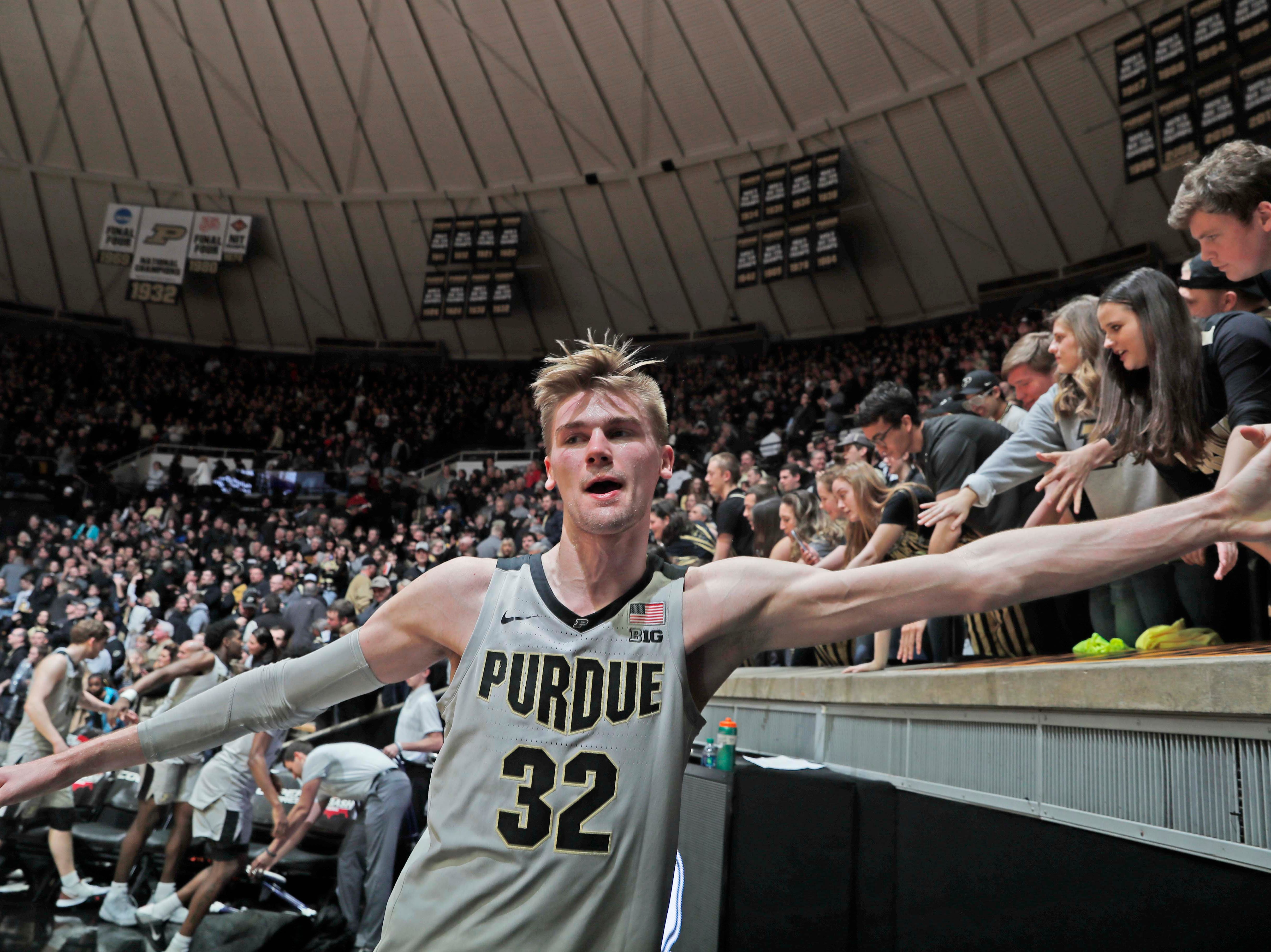 Feb 16, 2019; West Lafayette, IN, USA; Purdue Boilermakers center Matt Haarms (32) high fives the fans after the victory against the Penn State Nittany Lions at Mackey Arena. Mandatory Credit: Brian Spurlock-USA TODAY Sports