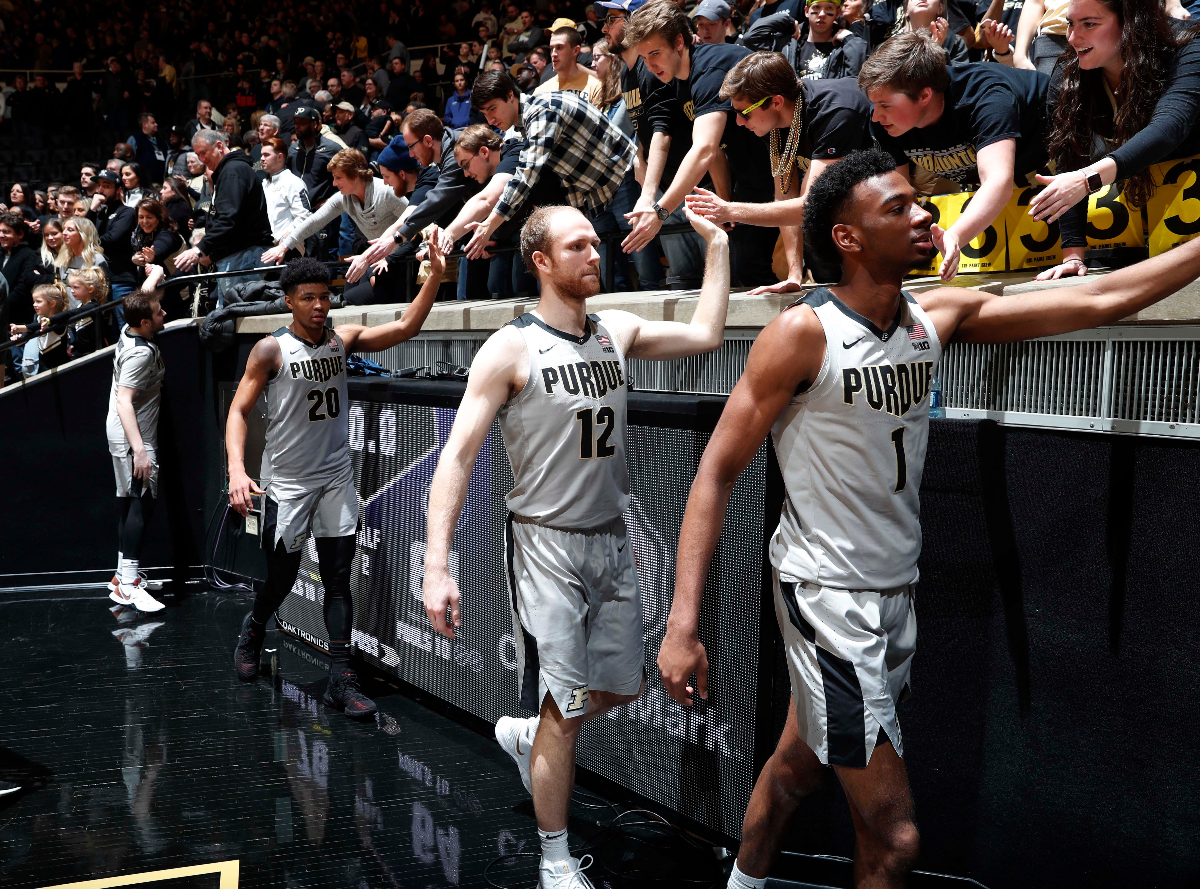 Feb 16, 2019; West Lafayette, IN, USA; Purdue Boilermakers high five the fans after the victory against the Penn State Nittany Lions at Mackey Arena. Mandatory Credit: Brian Spurlock-USA TODAY Sports