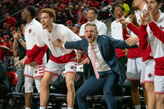 The Ragin' Cajun bench erupts after a big play in UL's 83-76 win over UL Monroe on Saturday night at the Cajundome.