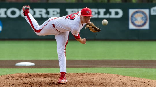 "Brandon Young hurls a pitch as the UL Ragin Cajuns take on Texas at M.L. ""Tigue"" Moore field at Russo Park on Saturday. Young, a juco-transfer from Howard College in Texas, made his first start for the Cajuns on Saturday."