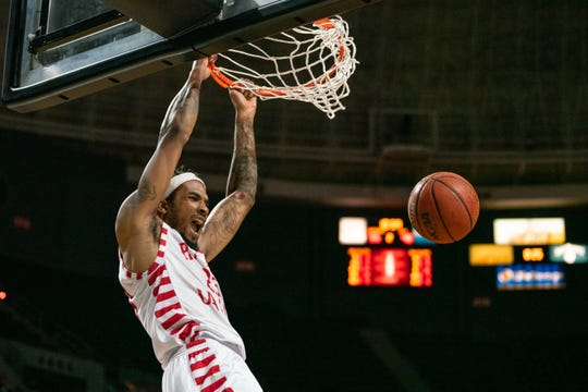 UL's JaKeenan Gant delivers one of his big dunks in Saturday night's win over UL Monroe. He finished with 20 points.