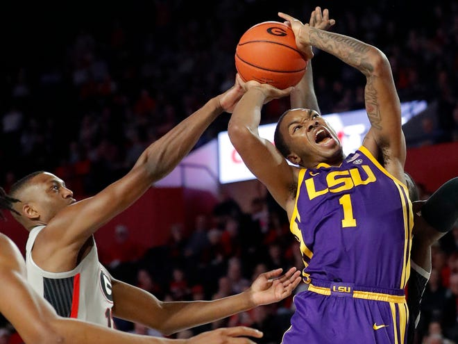 LSU guard Ja'vonte Smart (1) is fouled by Georgia guard Tye Fagan (14) as he goes in for a basket during the second half of an NCAA college basketball game Saturday, Feb. 16, 2019, in Athens, Ga. (AP Photo/John Bazemore)