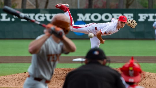 Connor Cooke hurls a pitch over home plate as the UL Ragin Cajuns take on Texas at M.L. Tigue Moore field at Russo Park  on Saturday. Cooke relieved Brock Batty and put the Longhorns down in order in the sixth in his debut as a Cajun pitcher.