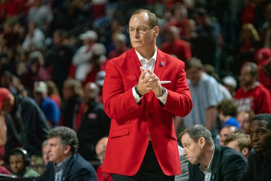 UL's head basketball coach Bob Marlin celebrates the play on the sidelines as the Ragin' Cajuns play against the UL Monroe Warhawks at the Cajundome on Saturday, Feb. 16, 2019.