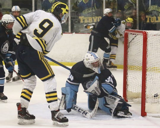 Hartland's Joey Larson puts the puck past Livonia Stevenson goalie Eric Polzin with 3:22 left in the second period on Saturday, Feb. 16, 2019, but it was ruled the net was dislodged.