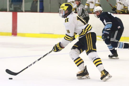 Hartland's Brendan Tulpa carries the puck up the ice in a 5-2 loss to Livonia Stevenson in the KLAA championship hockey game on Saturday, Feb. 16, 2019.