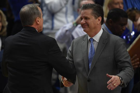Tennessee coach Rick Barnes and Kentucky coach John Calipari shake hands after UK's win over UT in February. The stakes are higher in Saturday's showdown.