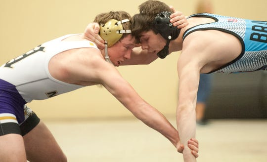 Male's Zane Brown, left, and Union County's Stephen Little square off during the 160 lb. wrestling championship bout of the KHSAA state wrestling championships in Alltech Arena in Lexington, Ky.16 February 2019