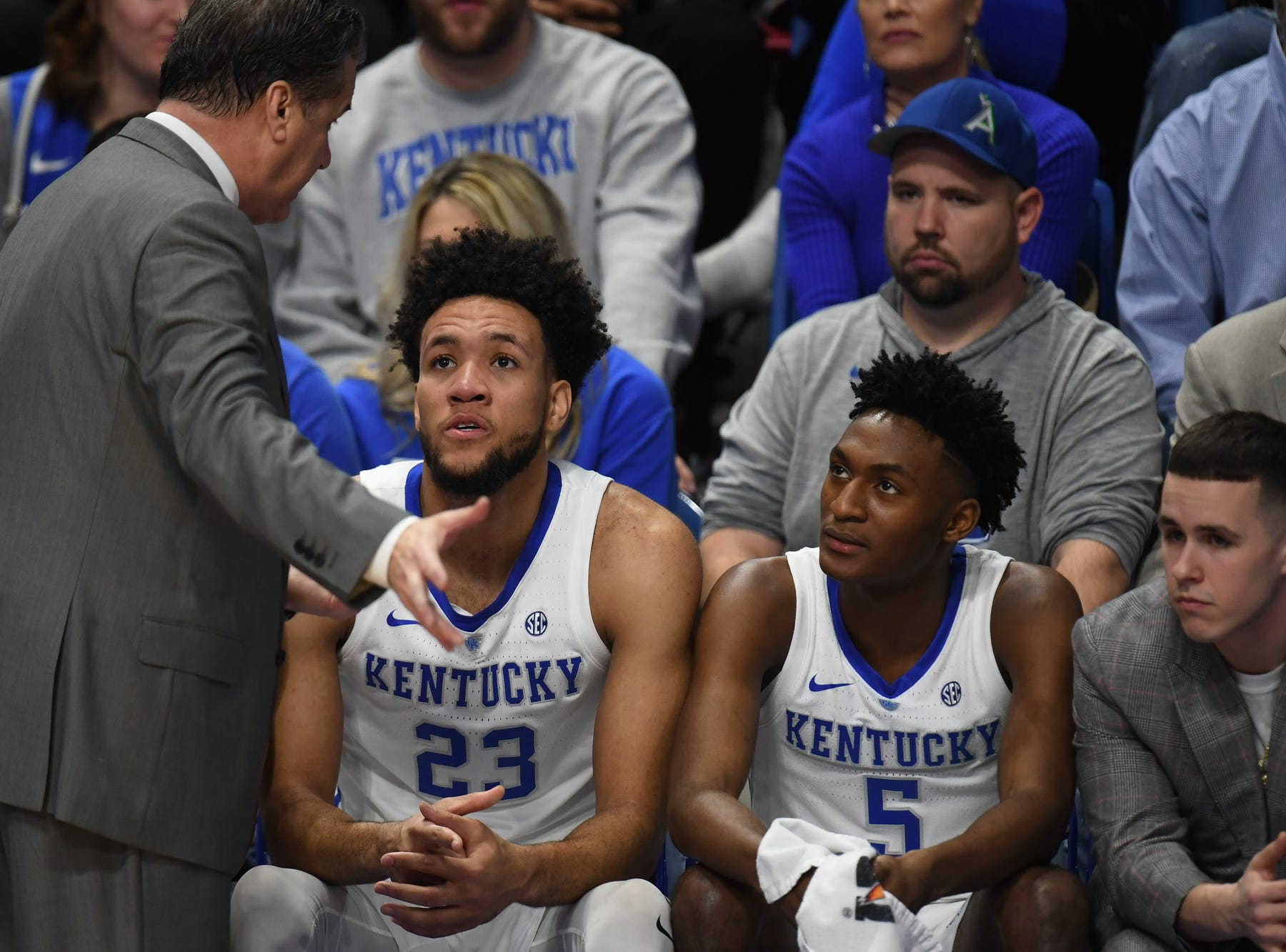 UK head coach John Calipari talks with F EJ Montgomery and G Immanuel Quickley during the University of Kentucky mens basketball game against Tennessee at Rupp Arena in Lexington, Kentucky on Saturday, February 16, 2019.