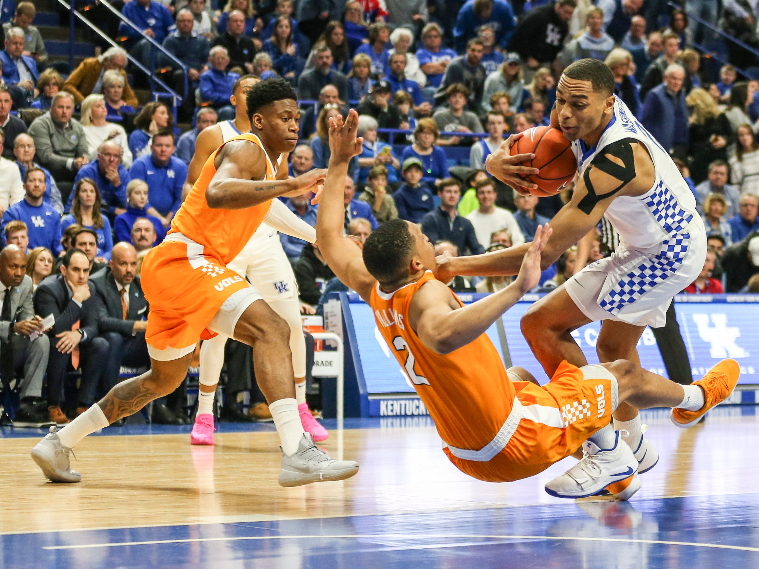 Kentucky's PJ Washington Jr was called for the charge against Tennessee's Grant Williams in his first drive during the first half. Feb. 16, 2019