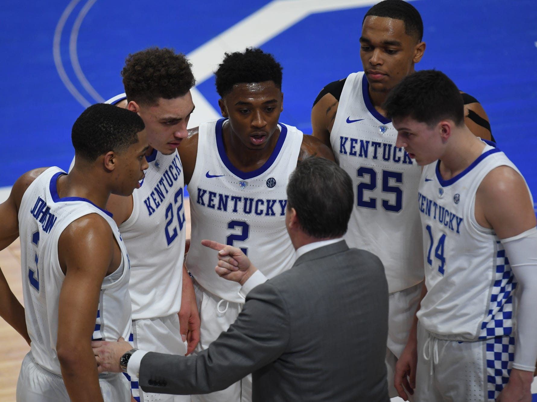 UK head coach John Calipari huddles with his starters  during the University of Kentucky mens basketball game against Tennessee at Rupp Arena in Lexington, Kentucky on Saturday, February 16, 2019.