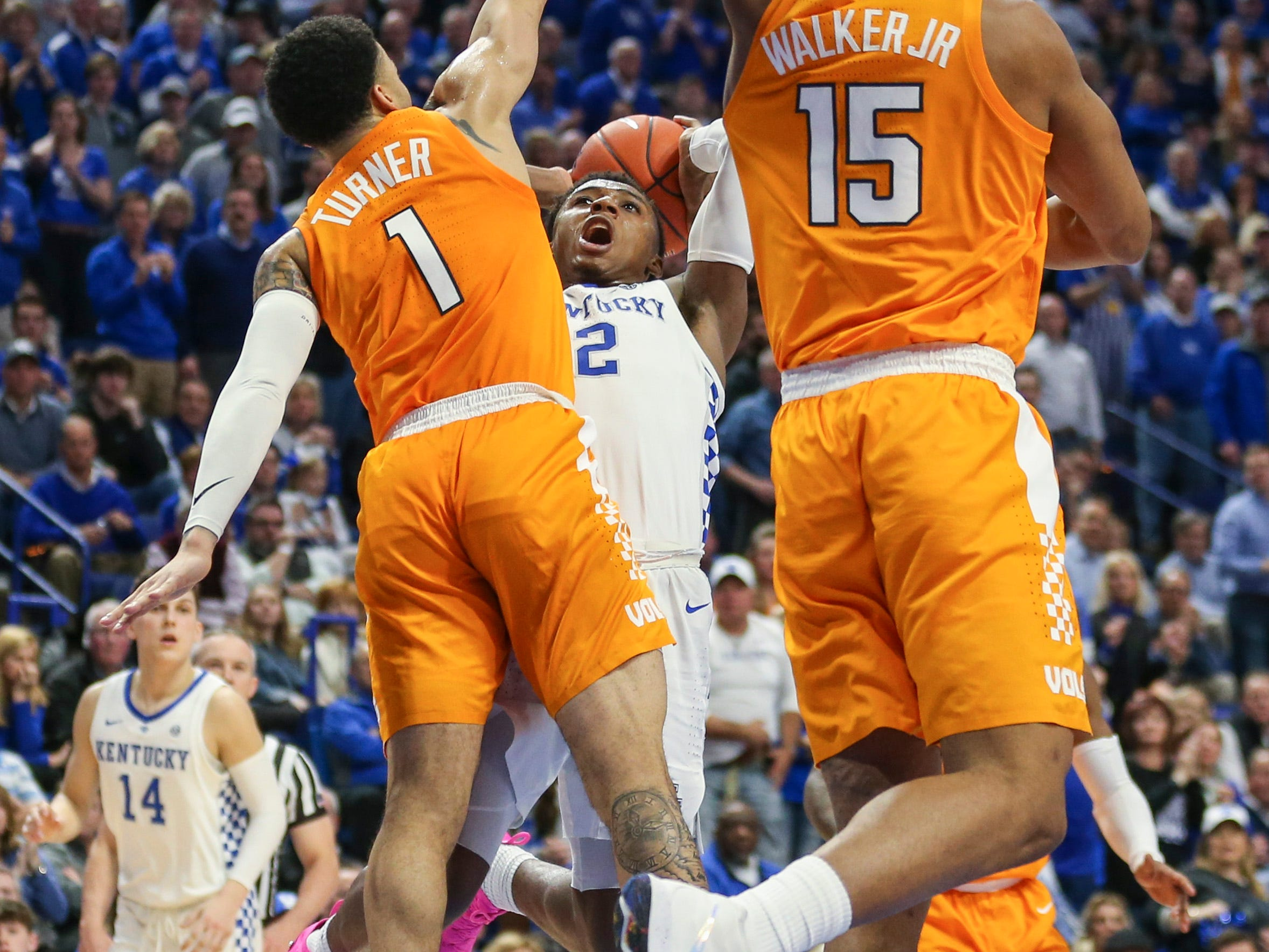 Kentucky's Ashton Hagans tried to score while double teamed by the Volunteers' Lamonte Turner and Derrick Walker during the Wildcats' win over No. 1 Tennessee 86-69 Saturday night. Hagans finished with nine points and team high seven assists. Feb. 16, 2019
