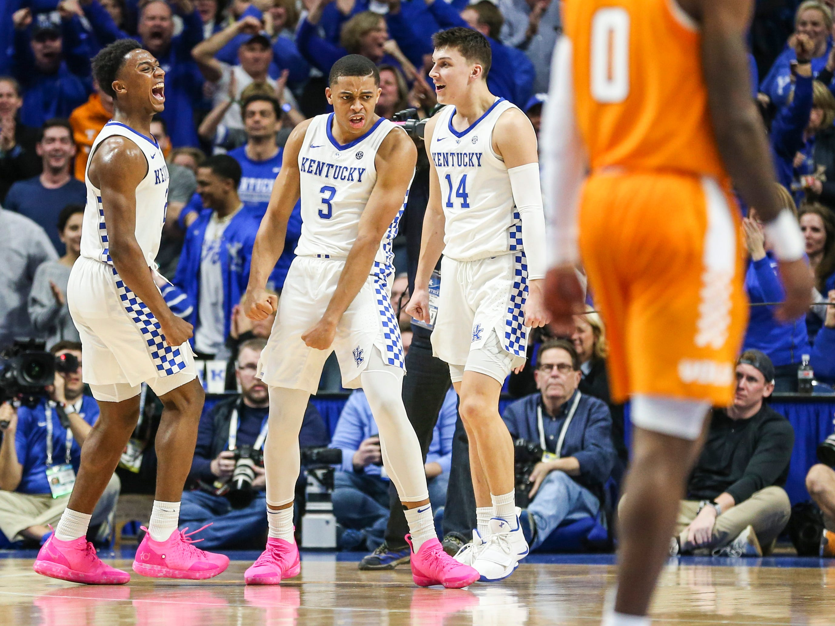 Kentucky's Keldon Johnson celebrates with Ashton Hagans in the second half during the Wildcats' win over No. 1 Tennessee 86-69 Saturday night. Herro finished with 15 points and 13 rebounds and three assists. Feb. 16, 2019
