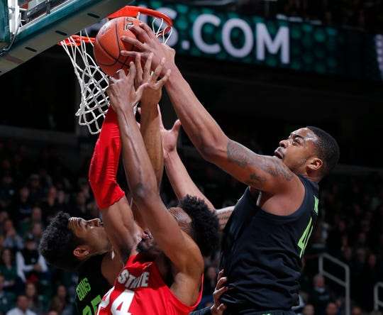 Michigan State's Nick Ward, right, and Kenny Goins, left, and Ohio State's Andre Wesson, center, battle for a rebound during the first half of an NCAA college basketball game, Sunday, Feb. 17, 2019, in East Lansing, Mich. (AP Photo/Al Goldis)