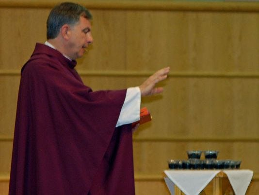 Father Mark Inglot blesses ashes before their distribution to the congregation in 2009 at St. John Student Parish.