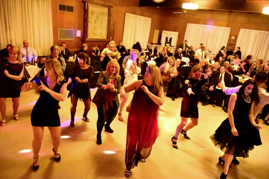 Members of the Women's Club show off their moves during the Turn Up The Heat dance competition Saturday night. The event raised more than $18,000 for the club.